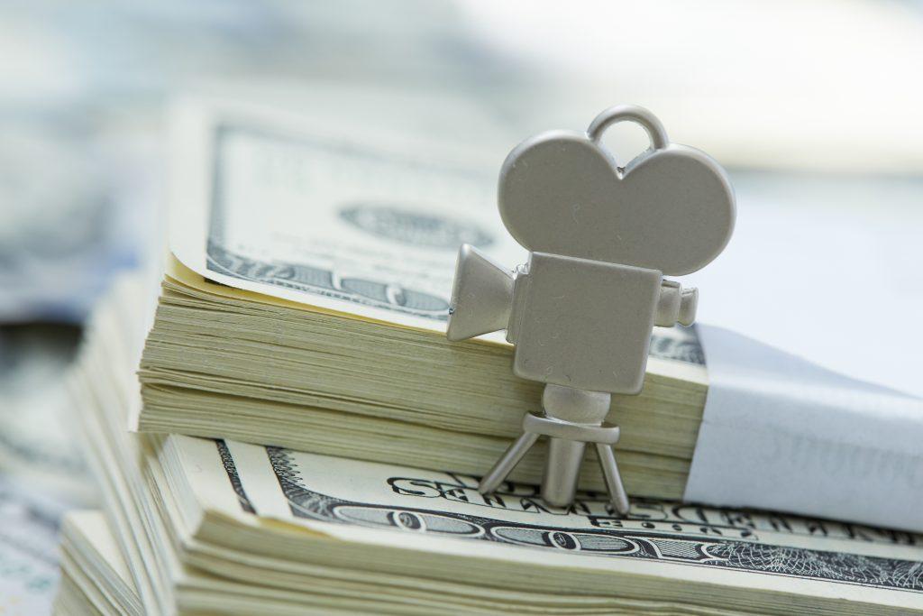 notes of dollars, movie camera